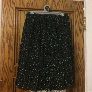 Slightly used black with white polka dots skirt.